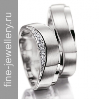 Изогнутые обручальные кольца из белого золота с бриллиантами