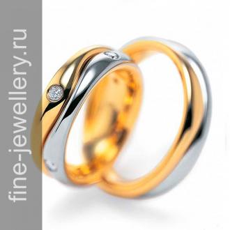 Обручальные кольца двухцветные с бриллиантами