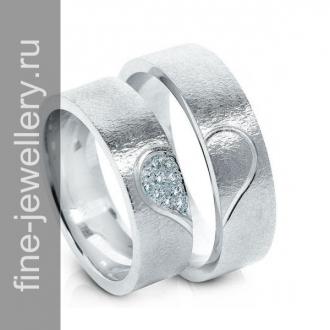 Обручальные кольца с половинками сердца