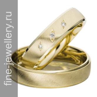 Обручальные кольца с тремя бриллиантами