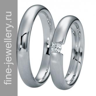 Обручальные кольца с большим бриллантом