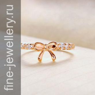 Кольцо в виде бантика из золота